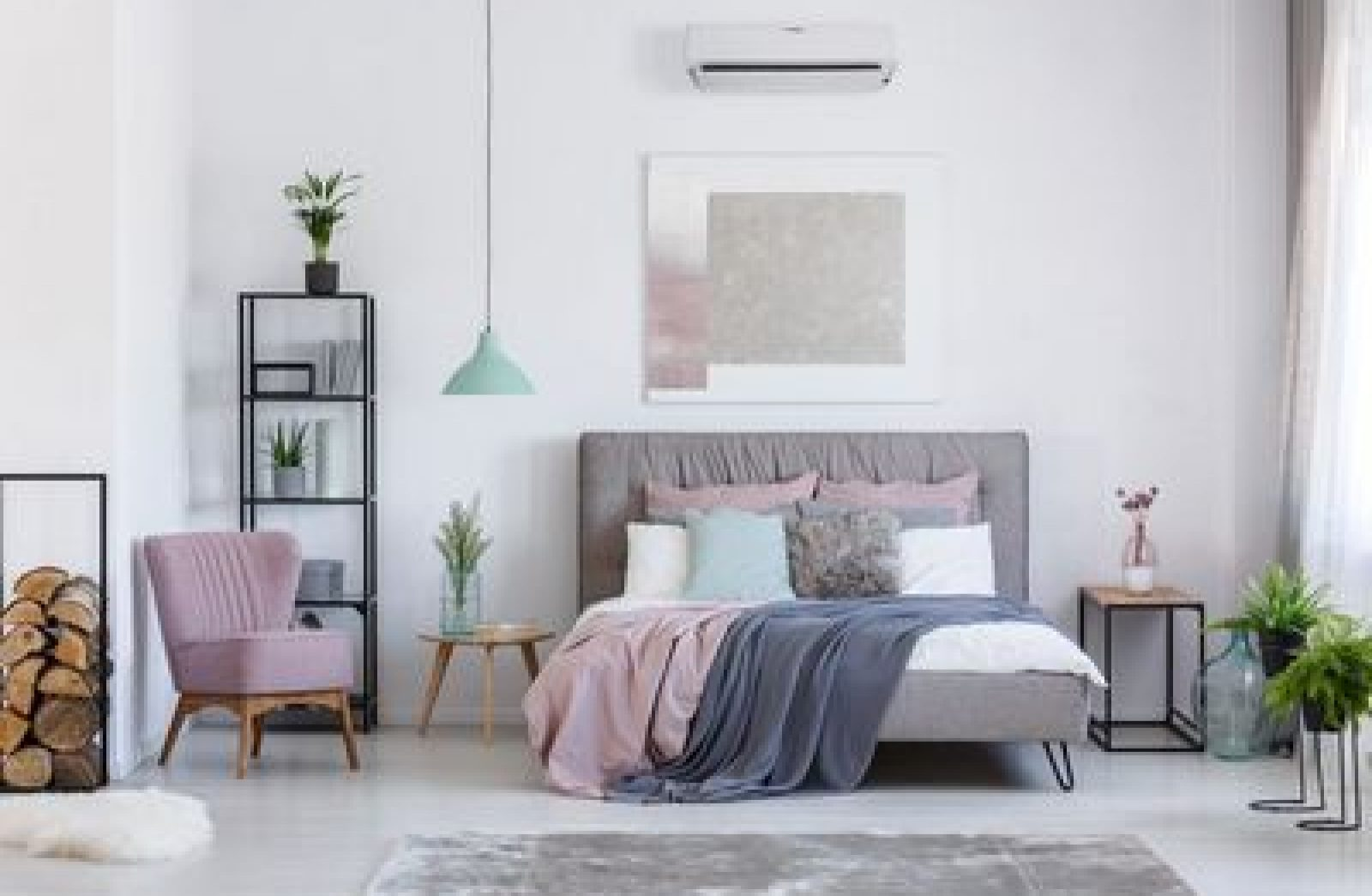 Comfortable powder pink chair next to shelf with firewood in soft pastel bedroom with decorative glass vases; Shutterstock ID 726726967; Client/Licensee: -