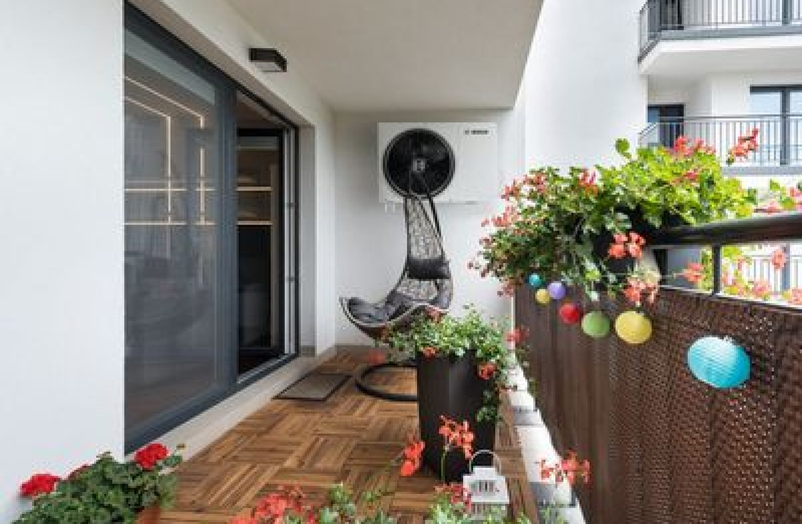 Home terrace with wooden floor and chair; Shutterstock ID 675585040